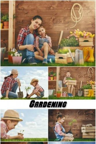 Mother and her daughter in gardening